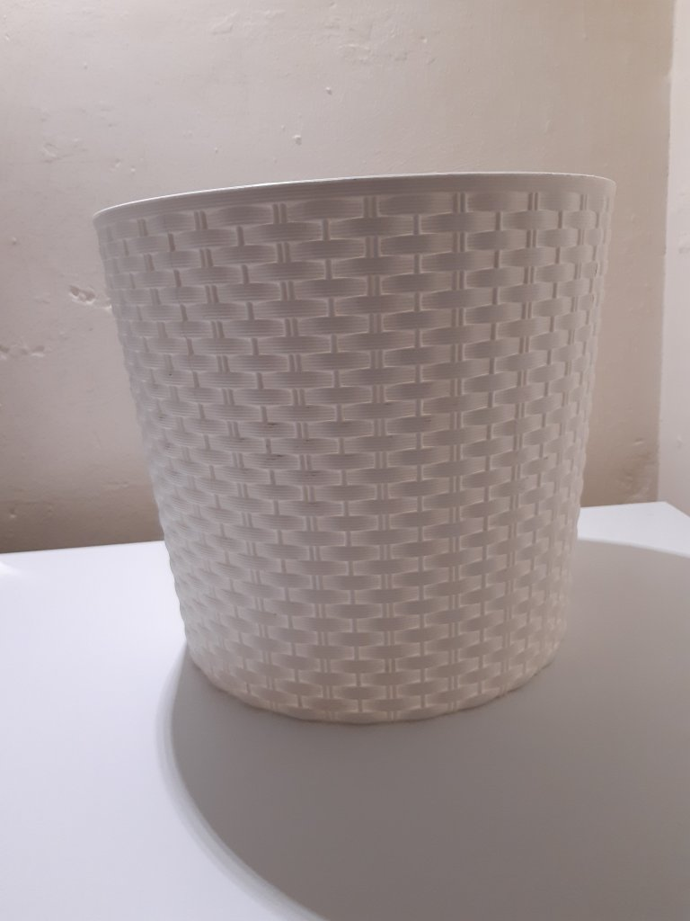 A white plaint container- A stand for Bat Bites.